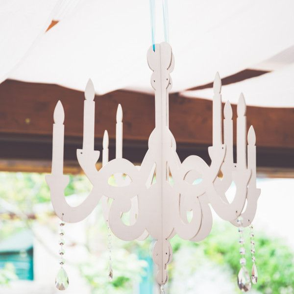 This wooden chandelier by Made In Heaven is a must for your elegant wedding :)
