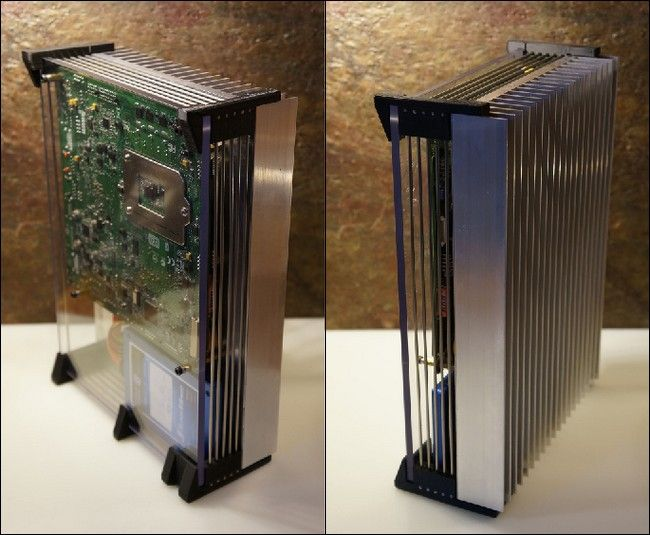This silent media center PC dissipates heat in a rather clever way; the entire back of the case is one giant heatsink. Description from howtogeek.com. I searched for this on bing.com/images