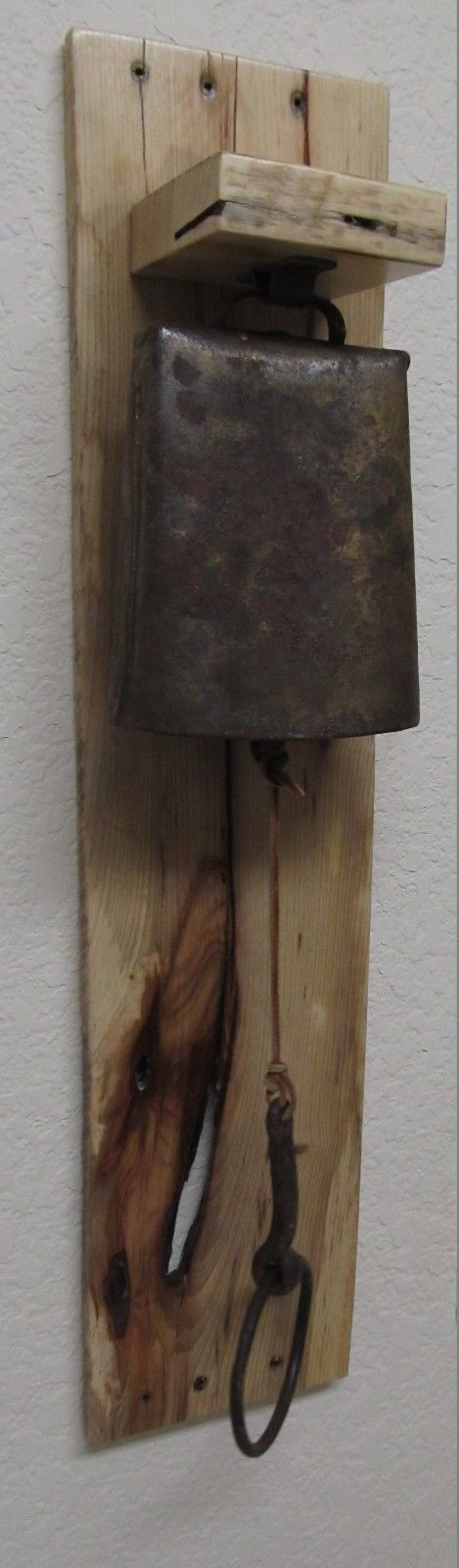 A Vintage Cow Bell on a very cool and rustic by RedeemWood on Etsy