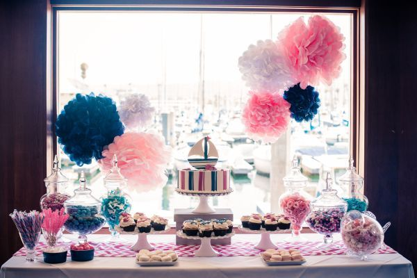 nautical baby shower ideas, nautical themed party, baby shower, baby girl, Blue Water Grill Captain's Cabin, Cupcakes Couture of Manhattan Beach, macarons, cupcakes, starfish, boats, sailing, ocean, boat, glass fish bowl, glass containers, pink rock candy, pink, blue, taffy, candy, candy canes, door stoppers, baby clothes, Juicy Couture