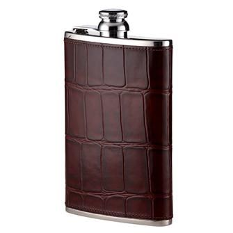 A hip flask is an indispensable accessory, to be taken on country walks, shoots, picnics and any outdoor event where a nip of something warming may be required. This classic hip flask, handmade from polished stainless steel and covered in the finest leather, has either a 4oz, 6oz or 8oz capacity, and will fit neatly into a coat pocket.