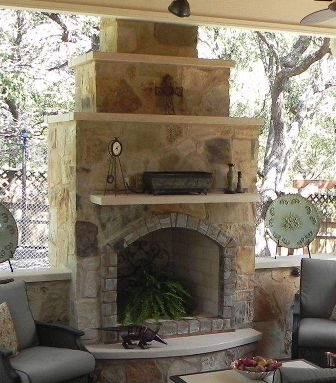 Simple Outdoor Kitchens And Patios | This Austin Patio Cover Features A  Custom Stone Outdoor Fireplace