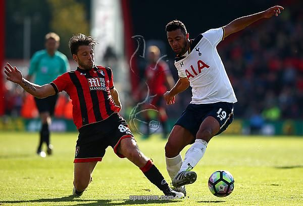 BOURNEMOUTH, ENGLAND - OCTOBER 22: Harry Arter of AFC Bournemouth (L) and Mousa Dembele of Tottenham Hotspur (R) battle for possession during the Premier League match between AFC Bournemouth and Tottenham Hotspur at Vitality Stadium on October 22