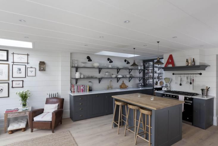 Gray and white London kitchen renovation, open shelving inspired by French bistros, Remodelista