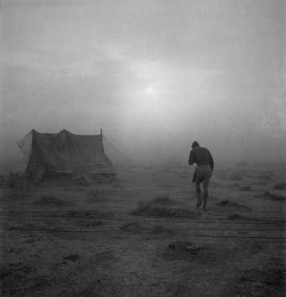 A soldier battling his way through a sandstorm in the Western Desert during 1942.  Beaton, Cecil  © IWM (CBM 1358)