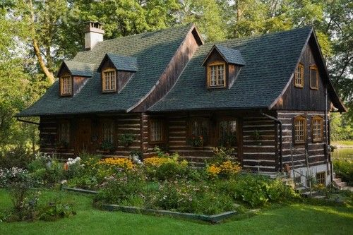love the design & rustic elements of this log cabin...would love to have one someday...