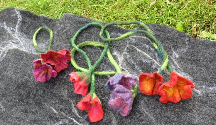 Tried out felting flowers with different colour combinations. Was actually more fun than expected. Not sure what to do with them though…