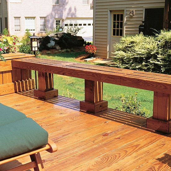 Low built-in benches function as seating and an edge barrier for this railing-free deck.