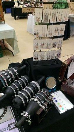 Use wine bottles spray painted black as jewelry display