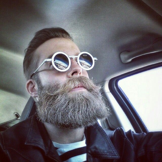 Want to play down goofy eyewear? Grow a goofy beard.
