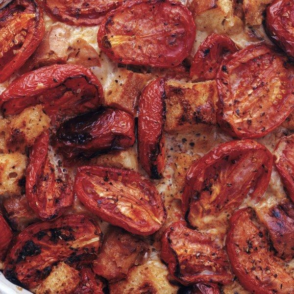 This homey dish made everyone in the test kitchen swoon.          Roma tomatoes become even more intense when roasted, and this comforting, custardy bread pudding proves the perfect match          for their bright flavor. Take it to a potluck, serve it with something          grilled, or make it a vegetarian main dish with a green salad.