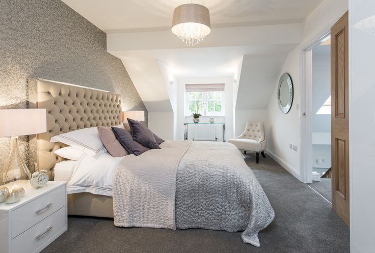 A sleep sanctuary created with luxurious, layered bedding, soft lighting and minimal accessories,
