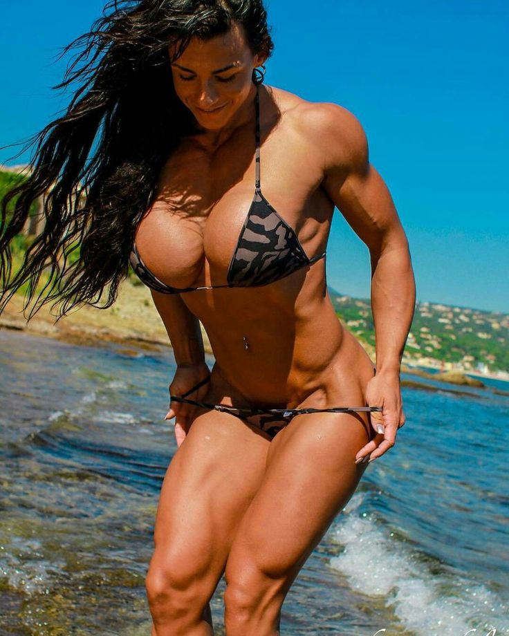 Beautiful female bodybuilders posing on stock footage photo