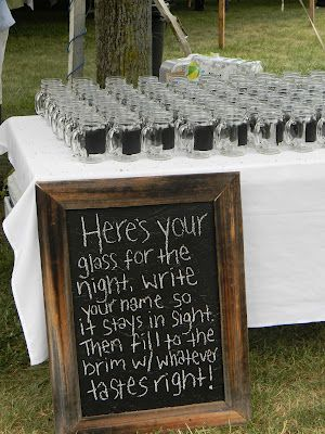 Mason Jars w/ chalkboard paint. Great as a wedding favor, plus there's never a dispute on the guest's drinks.