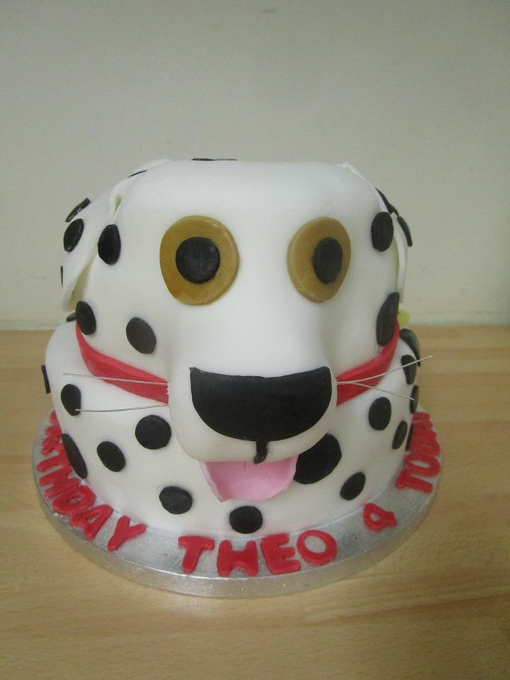 The head of this dalmation puppy was pieced together from a larger cake. The snout piece had a little help from a couple of drinking straws to hold it on, as well as lots of buttercream of course.