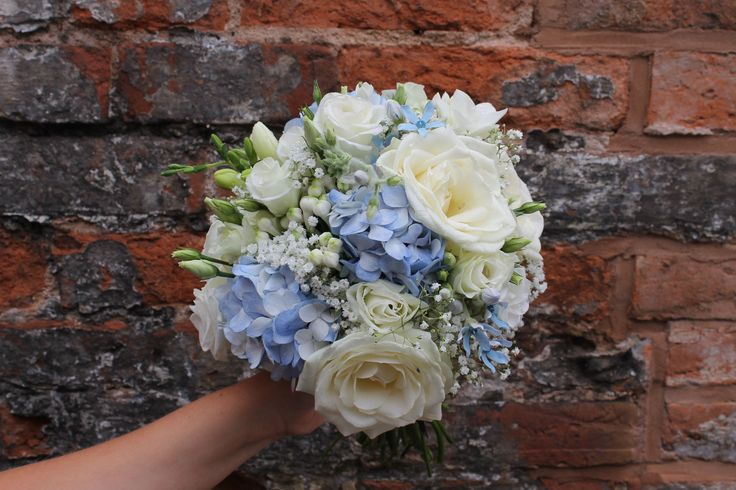 bridesmaid's bouquet - hand tied design - pale blue and ivory flowers - delphinium - hydrangea - avalanche rose - oxypetalum - gypsophila - freesia and lisianthus