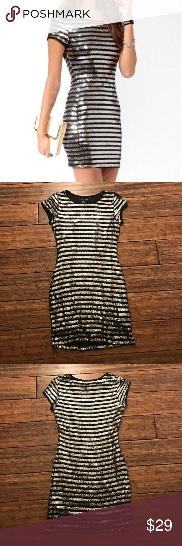 """Forever 21 Black and Silver Striped Sequin Dress F21 striped Sequin dress. Only worn once, perfect for a special occasion! Approx. 31.5"""" long. 12.5"""" across waist, 15"""" armpit to armpit, and 15"""" across hips. Shell: 87% rayon, 3% spandex/elastane. Lining: 100% polyester. This has stretch to it. Forever 21 Dresses Mini"""