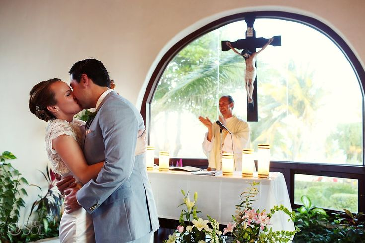 First kiss, so romantic! Lovely bride and groom at a destination wedding in Playa del Carmen, Mexico.  Mexico wedding photographers Del Sol Photography