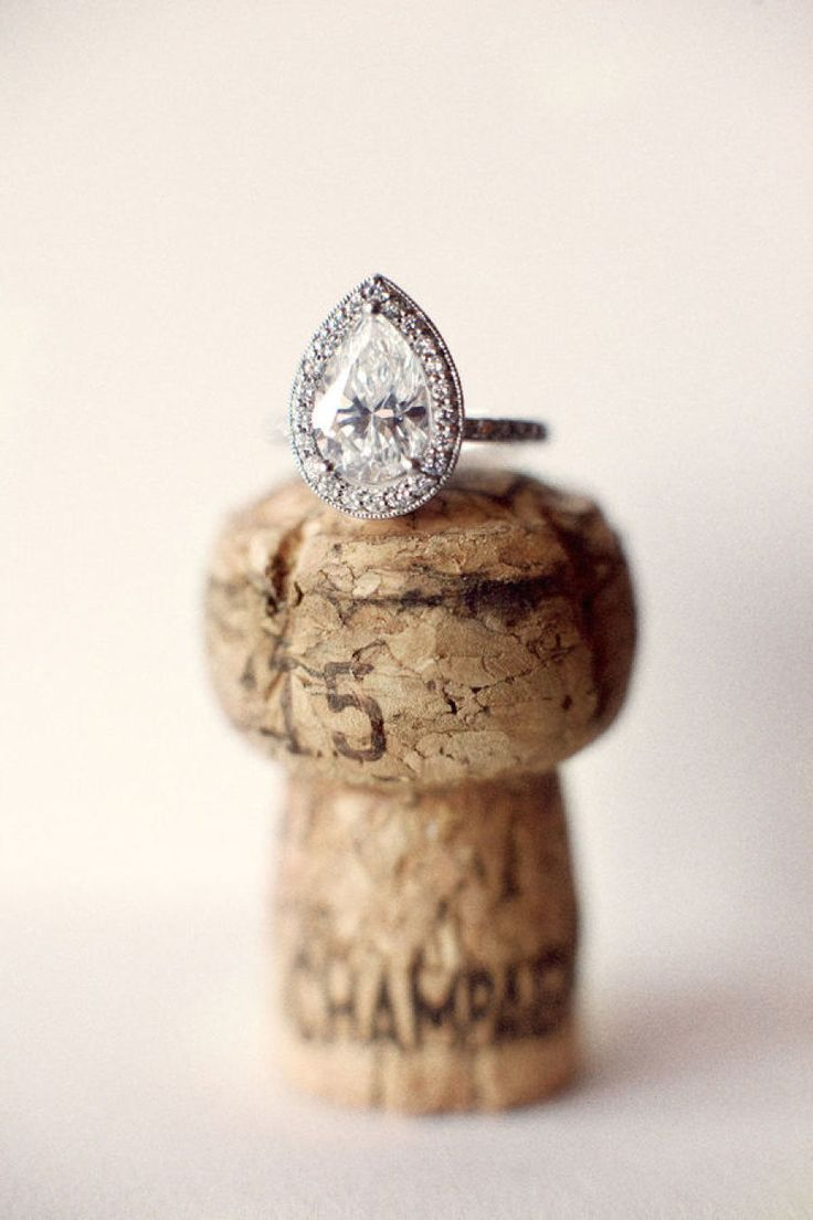 Pear-cut engagement ring in a halo setting: Photography: Aaron Delesie