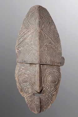 Lower Sepik Mask - This large stylish Lower Sepik mask has etchings throughout with a zoomorphic creature carved into its forehead. With an extended tongue and fine nose, the piece may be a representation of a village ancestor. Eroded from time around the lower sections,there still remains evidence of white pigment within the groves of the etchings.    Ewa Oceanic Sepik Gallery - Oceanic Art