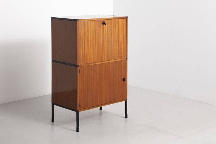 French secretaire designed by ARP (Joseph-André Motte – Michel Mortier – Pierre Guariche) in 1954. Elm with black metal legs and blue folding desk. Made in France by Elements Minvielle.