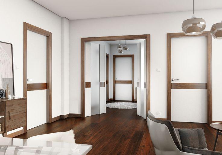 Para conseguir un ambiente elegante, combina un impecable lacado blanco con madera de nogal. El resultado te encantará.
