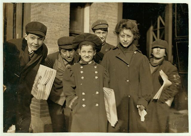 Hartford newsboys and girls. Girl in middle, Nellis, is 9 years old. See label on photo 640. [Caption #640: A 9 year old newsgirl in Hartford, Conn. She sold later than this sometimes. Been selling two years.] Location: Hartford, Connecticut. Date Created/Published: 1909 March.