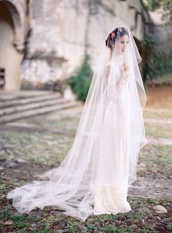 Bride with floral crown and cathedral veil