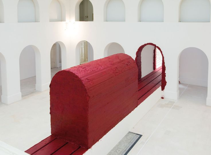 Displayed in the Royal Academy of Arts in London, Anish Kapoor - 'Svayambh' (meaning self generated) consists of a 3 by 2.5m block of Red (made from vaseline, red paint and wax),