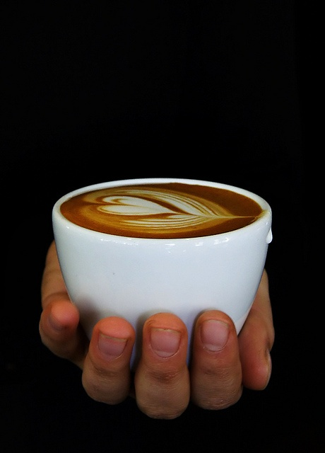 handing you a cappuccino with love