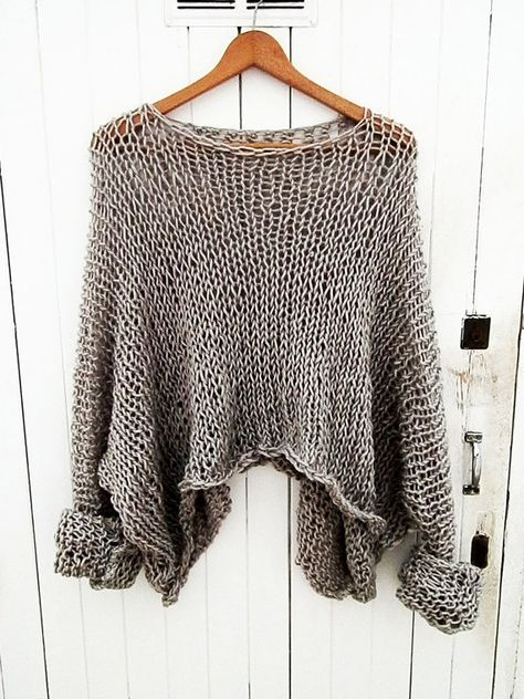 Diese schöne übergroße Pullover Features einfac…