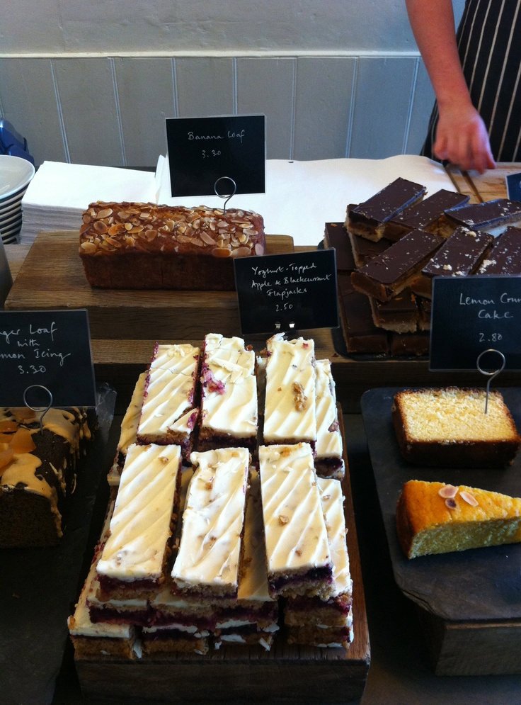Cake display cake cabinet pinterest wooden boards for Coffee shop display ideas