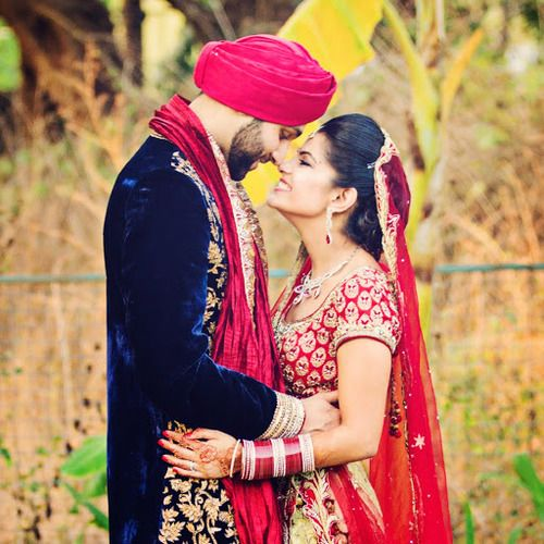 A happy hindu couple takes a moment to pose for this - Punjabi desi pic ...