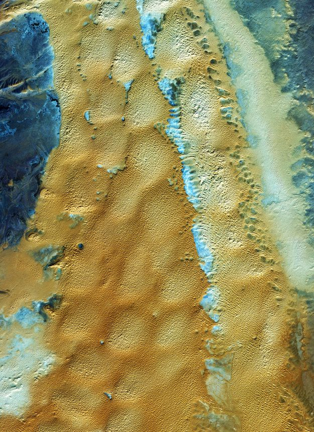 Earth from Space: Algerian sands by esa.int: This image from the Ikonos-2 satellite shows the sandy and rocky terrain of the Sahara desert in western Algeria. The largest country in Africa, Algeria is covered more than 90% by the Sahara desert. Major oil and natural gas deposits lie beneath the Sahara, contributing to Algeria's position as one of the wealthiest African nations. #Satellite_Image #Ikonos_2 #Algeria