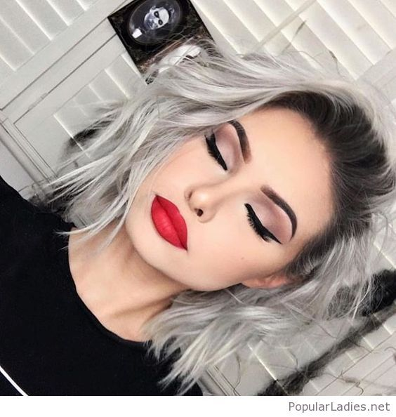 Grey hair and red lips