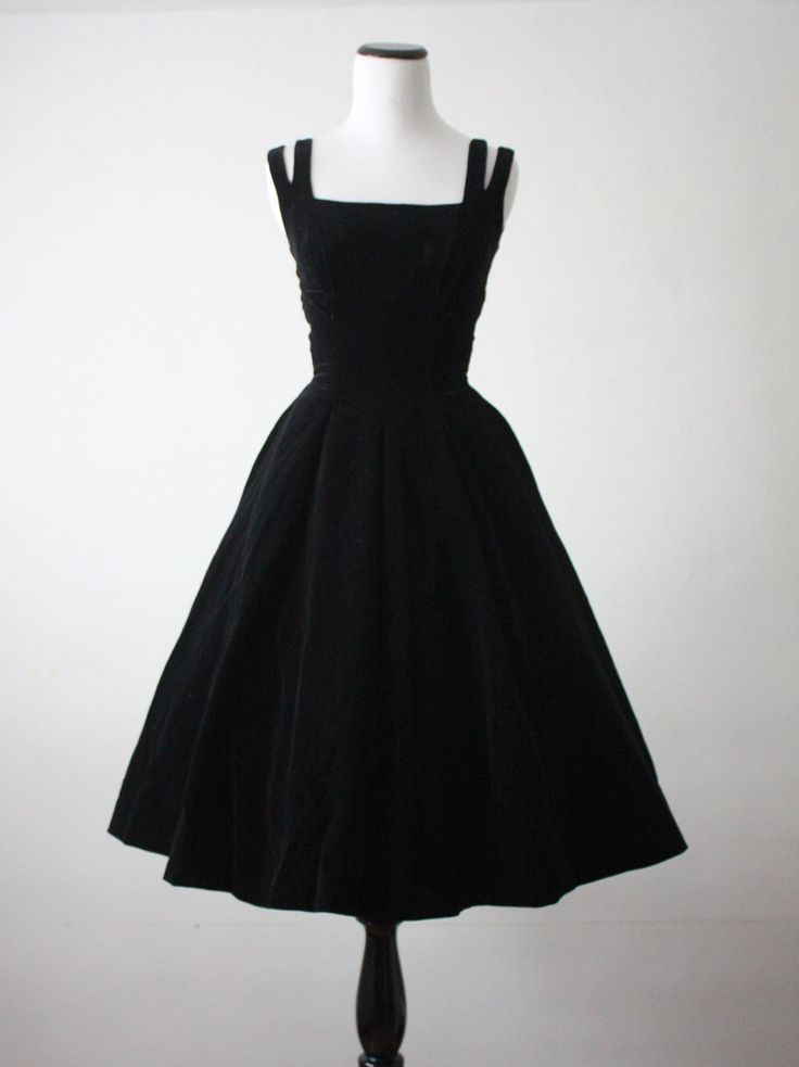 A queen can have her own style when it comes to the little black dress! Check out this vintage 1950s black velvet dress!