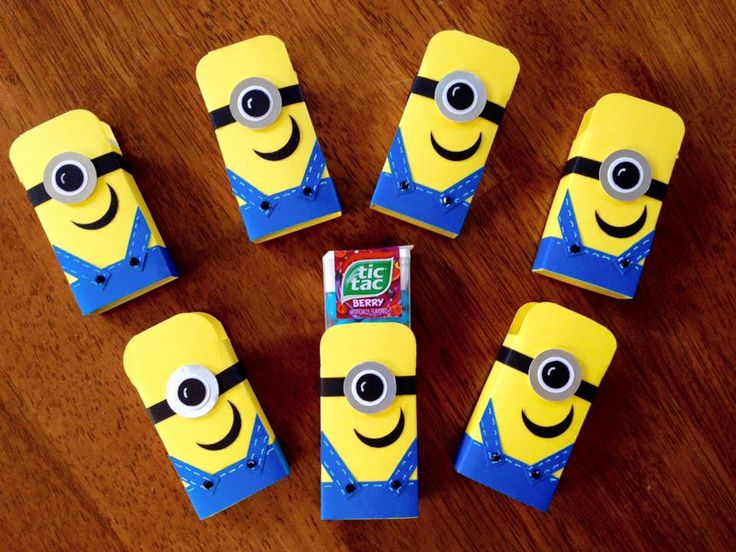 """2015 Part 1 of 2 created by Diane Beaudoin Instructions for Minion Tic Tac holder: Piece of yellow card stock 4 1/4 x 2 3/4 in. Score at 1/2, 1 7/8, 2 3/8, and 3 3/4"""".turn and score at 2 1/8"""" (see picture.Part 2 of 2) Cut out the notches as shown in pic. Fold on the score lines and I used Tombow glue to hold the seam. Use a corner rounder punch for the top of the head."""