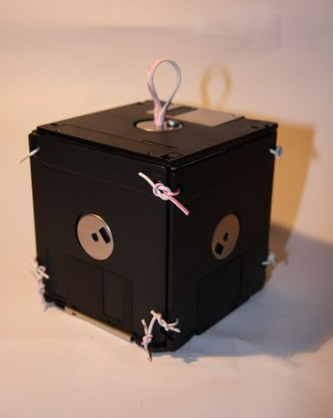 "Box made from old floppy discs and wire!  This one reminded of a little old lady that had an antique shop who would often say, ""That's not for sale, it's gonna be a collector's item."""