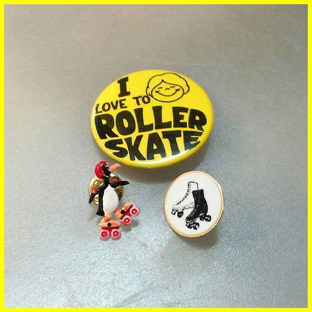 Vintage roller skating pins.
