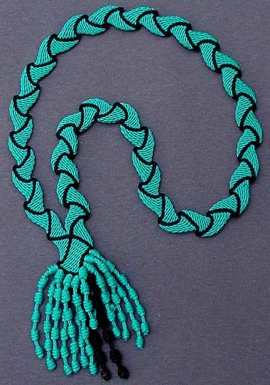 Ply-split necklace by Linda Hendrickson.  Worked in SCOT (single-course oblique twining with cotton cords.