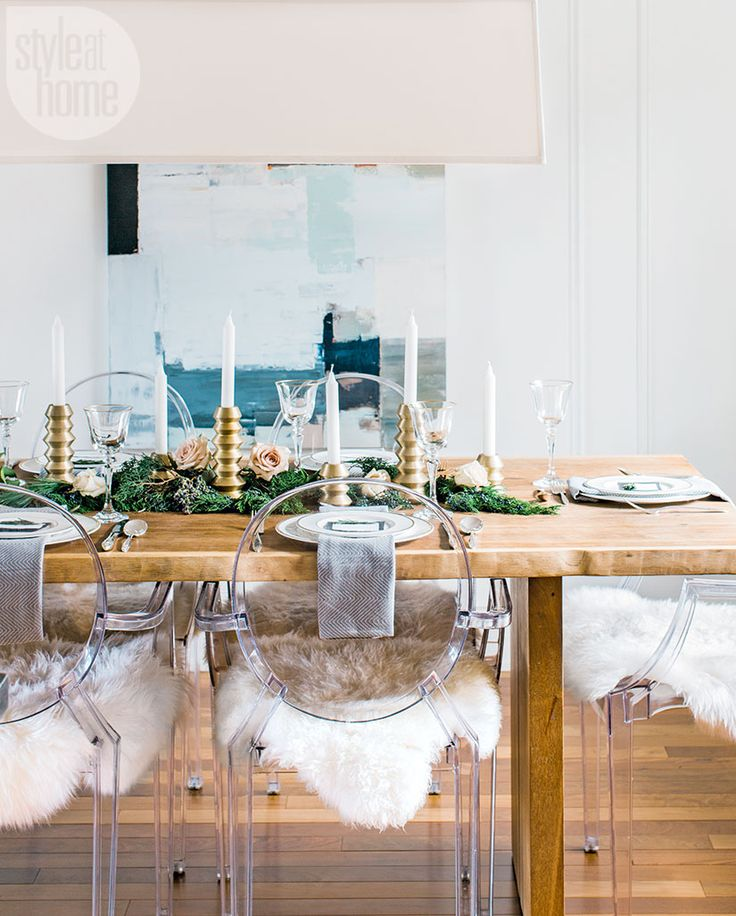 Christmas dinners take place at the modern farmhouse dining table, which is adorned with greenery, roses and gold candlesticks. | Image: Reid Lambshead | Designer: Sarah Walker | #DiningRoom #Tablescape #HolidayDecor #Christmas #DesignInspiration #StyleAtHome