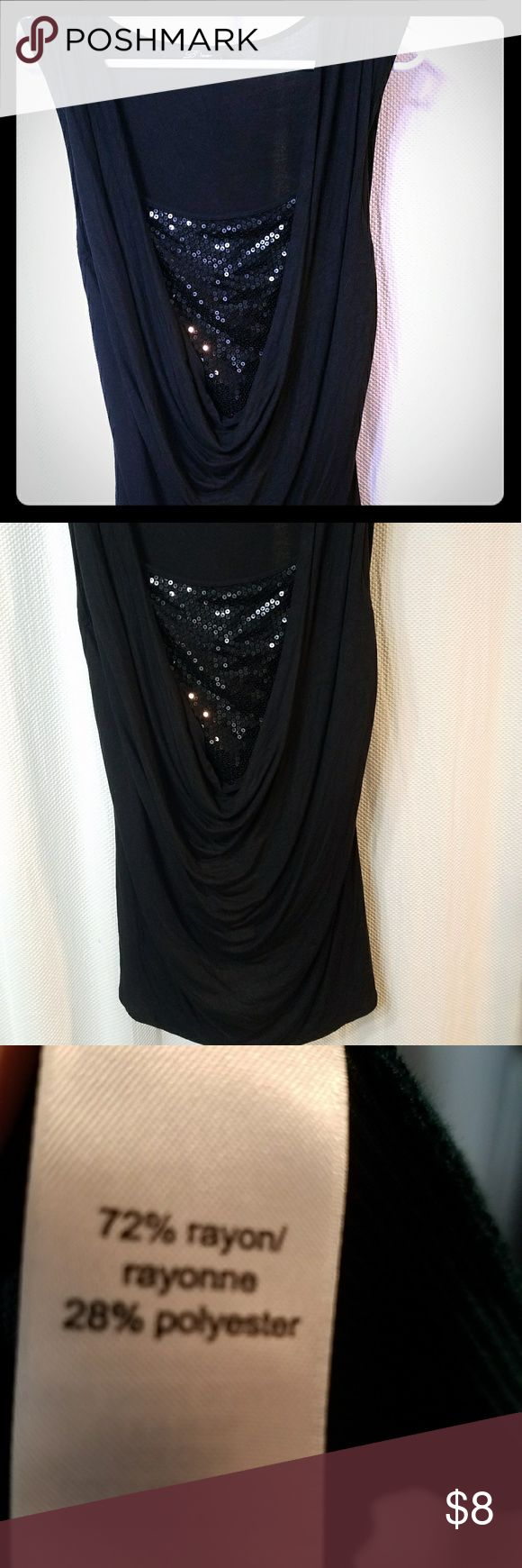 Night on the town sleeveless top. Bundle and save! Sleeveless, black top. Sequins at breast area, front is flowing, back is fitted. Super hot! Brand is B'leve Tops Blouses