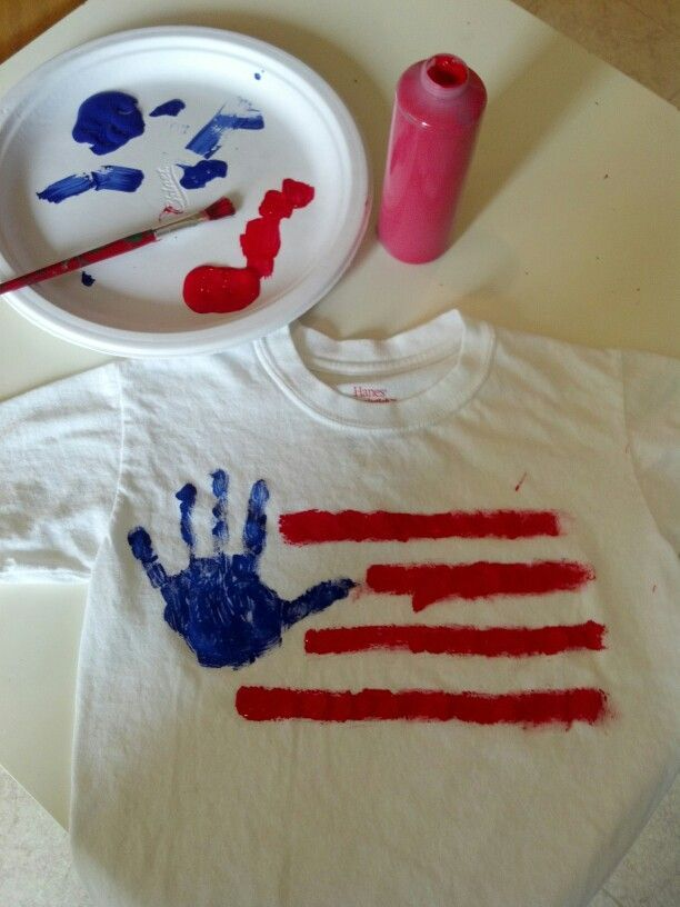 DIY - Fourth of July homemade Tee - The whole family could make one. White tee shirt, red and blue fabric pain.