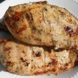 Marinated Grilled Chicken - This recipe can be used for inexpensive chicken pieces or to grill a whole chicken. The Italian salad dressing gives the dish some zing!