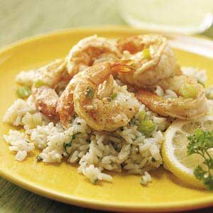 "Lemon Shrimp with Parmesan Rice Recipe -""I grew up in Biloxi, Mississippi, where rice, garlic and seafood are staples in Gulf Coast cuisine,"" says Amie Overby, now of Reno, Nevada. ""This dish is an easy, long-time family favorite that's ready in minutes."""