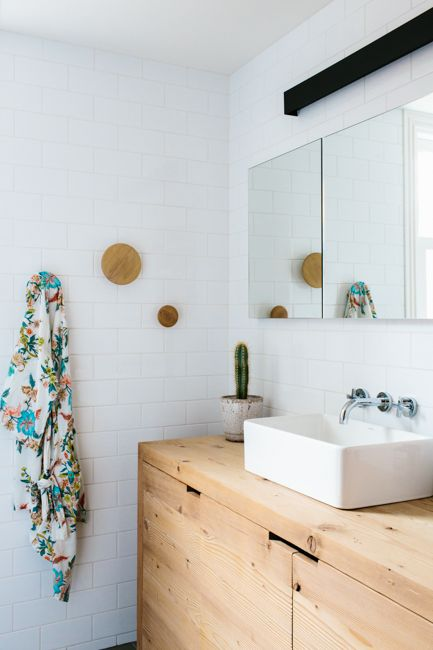 We love how the Muuto the Dots have been used as towel hooks in this bathroom http://www.nest.co.uk/search/muuto-the-dots-coat-hooks