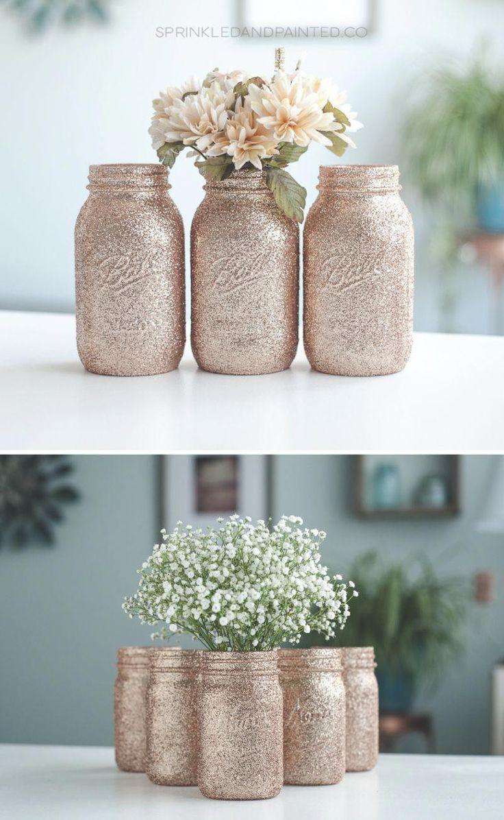 Rose gold wedding centerpiece table decor. Rose gold glitter mason jars. #rosegoldwedding
