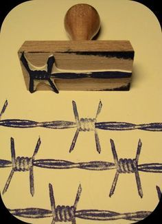 Hand-carved barbed wire stamp by Le Tampographe
