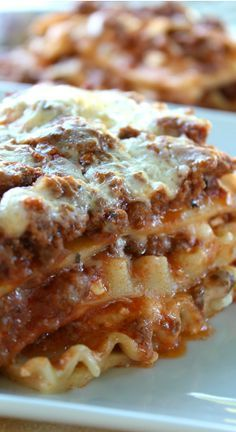 Classic Lasagna Recipe ~ This lasagna is loaded with of gobs cheese, from the mozzarella cheese, to the cottage cheese, to the parmesan cheese.
