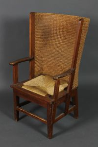Lot No 992 An Orkney style pine lambing chair with caned back and woven rush drop in seat, raised on square supports, sold for £410